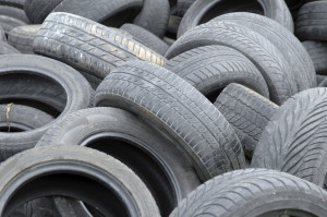Old abandoned and used tires waiting for recycling