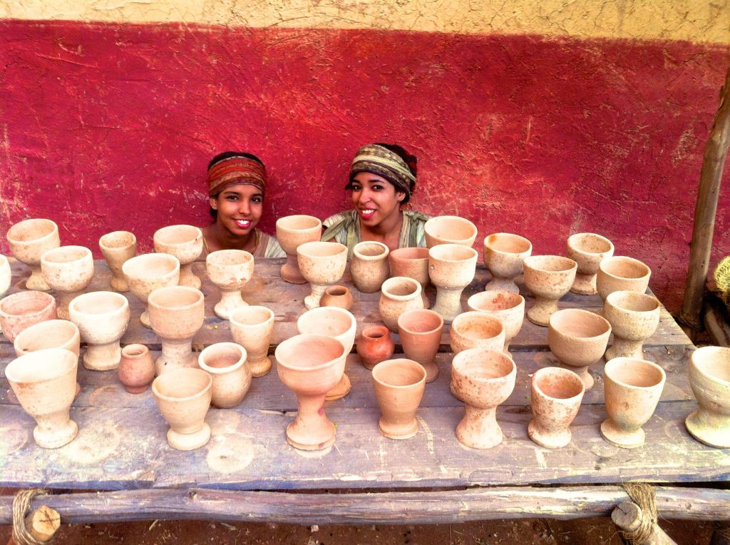 girls with clay cups